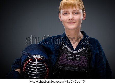 Female kendo fighter with men in the hand. Japanese martial art of sword fighting - stock photo