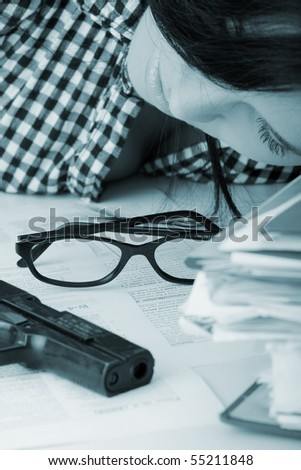 Female kiled her self while filling out tax forms while sitting at her desk. - stock photo