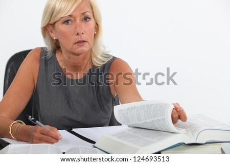 Female lawyer studying - stock photo