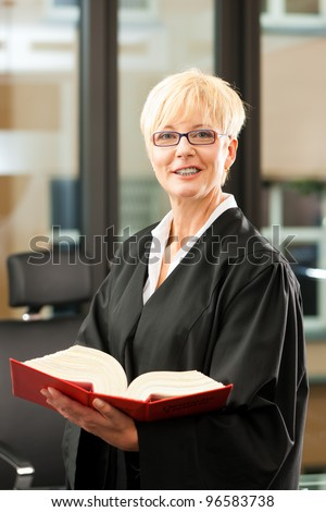 Female lawyer with German civil law code - only torso to be seen, close-up - stock photo