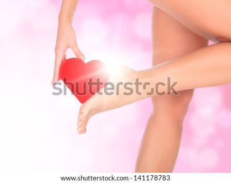 Female legs against a pink background with blurred lights - stock photo