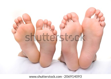 Female legs and male legs. - stock photo
