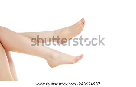 female legs closeup on white - stock photo
