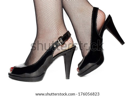 Female legs in black shoes isolated on white background. - stock photo