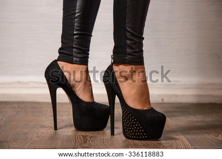 female legs in elegant black shoes with high heels - stock photo