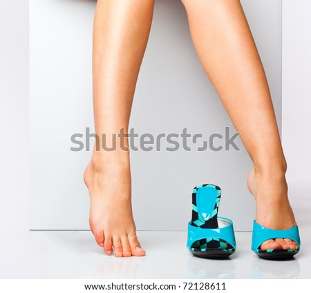 female legs in fashion shoes. isolated on a white background - stock photo