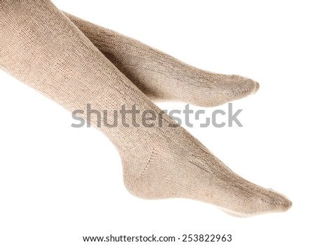 Female legs in knitted socks, white background, isolated - stock photo