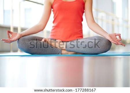 Female legs in lotus position - stock photo