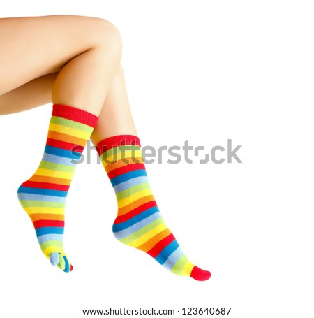 Female legs lifted in the air isolated on white. - stock photo