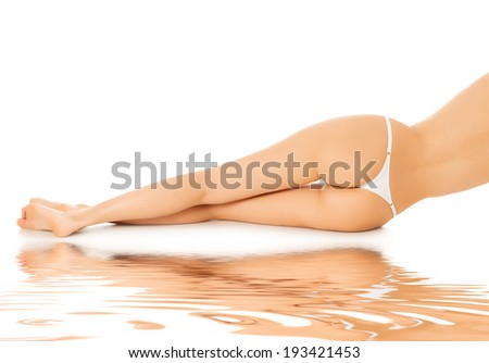 Female legs, veiw from behind, white background - stock photo