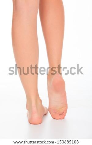Female legs, white background  - stock photo