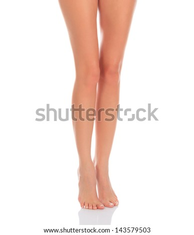 Female legs, white background, copyspace.  - stock photo