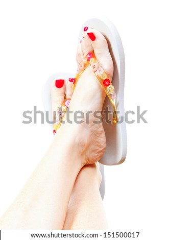 Female legs with flip-flops, isolated on white background. - stock photo