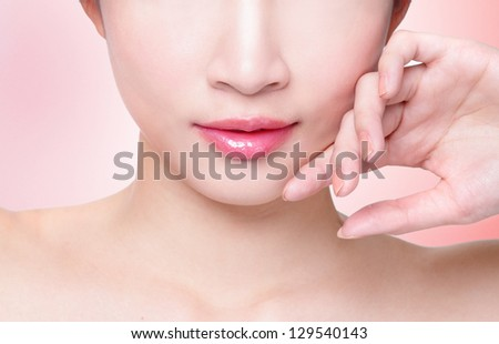 Female lips closeup. Beautiful smile of young fresh woman.  Isolated over pink background. asian model - stock photo