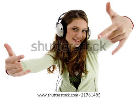 female listening to music and showing hand gesture on an isolated white background - stock photo