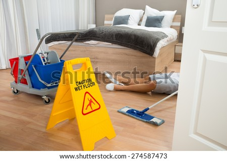 Female Maid Had Accident At Work While Cleaning Hotel Room - stock photo