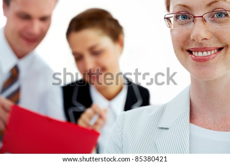 Female manager smiling against her two colleagues - stock photo
