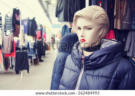 Female mannequin in the ware market - stock photo