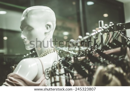 Female mannequins inside a fashion house, Color Effect - stock photo