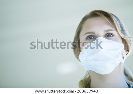 Female medical doctor with chinstrap - stock photo