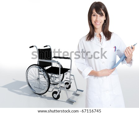 Female medical professional holding a folder with a wheelchair on the background - stock photo