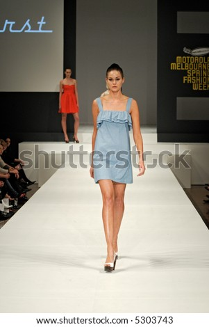 Female model at fashion show - stock photo