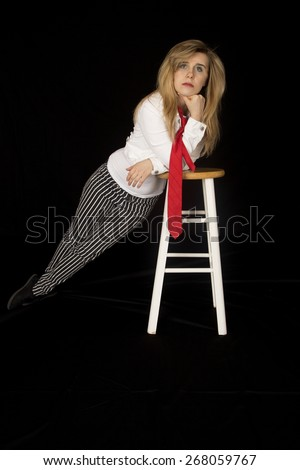 female model leaning on bar stool looking forward - stock photo