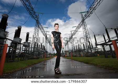 female model posing at a power plant - stock photo