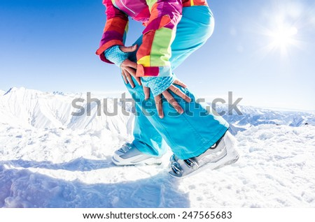 Female model posing her white skiing boots - stock photo