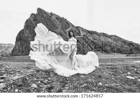 female model posing in a beautiful landscape - stock photo