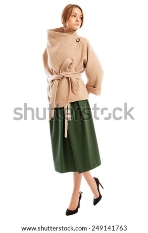 Female model wearing autumn or spring fashionable clothes and posing on white backrgound - stock photo