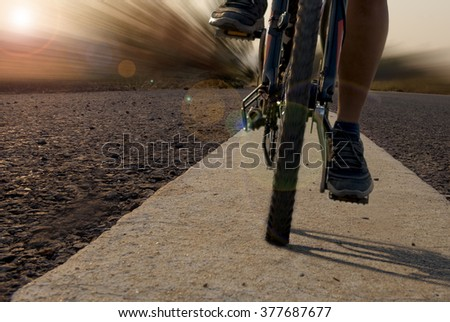female mountain bike rider on public road - stock photo