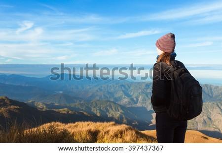 Female mountain climber enjoying the view. - stock photo
