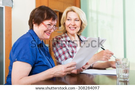 Female notary helping client drawing up of will - stock photo