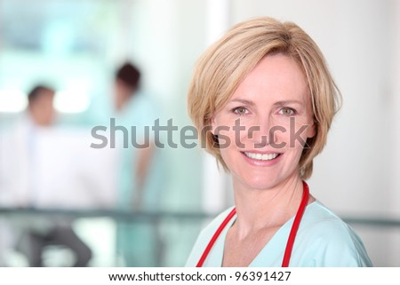 Female nurse in corridor - stock photo