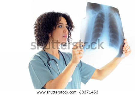 Female Nurse Looking At A Patients Chest X-Ray Wearing Hospital Scrubs - stock photo