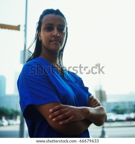 Female nurse outdoors - stock photo