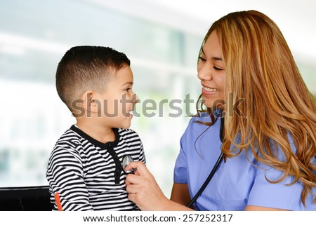Female nurse working at her office with a patient - stock photo