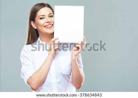 Female office worker hold white blank sign board. Isolated studio portrait of smiling business woman with long hair. - stock photo