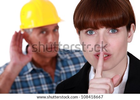 Female office worker making shush gesture - stock photo