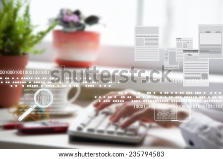 Female office worker typing on the keyboard. Blurred image. - stock photo