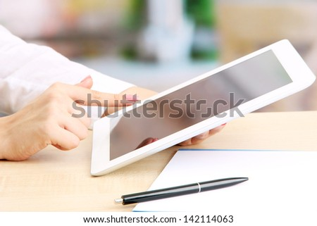 Female office worker using digital tablet in cafe - stock photo