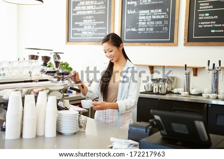 Female Owner Of Coffee Shop - stock photo