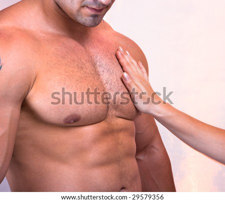 Female palm gentle touching male chest, two lovers - stock photo