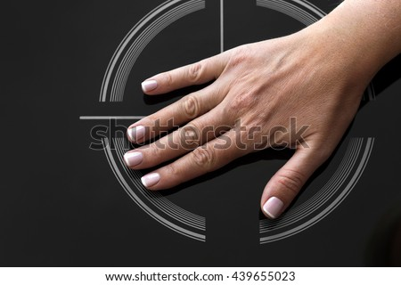 Female palm hand on on Induction stove. Showing that it's not hot - stock photo