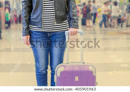 female passenger at the airport, vintage filter - stock photo