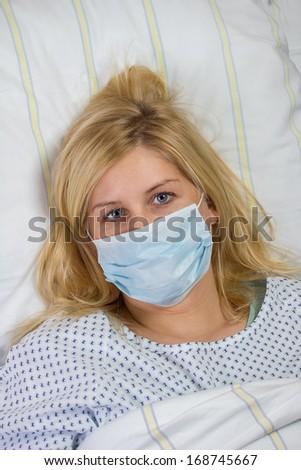 female patient in hospital quarantine - stock photo