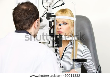 female patient is having a medical attendance at the optometrist - stock photo