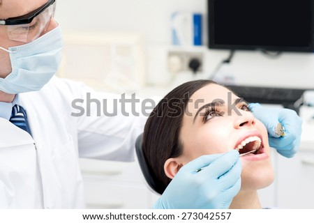 Female patient open her mouth during treatment - stock photo