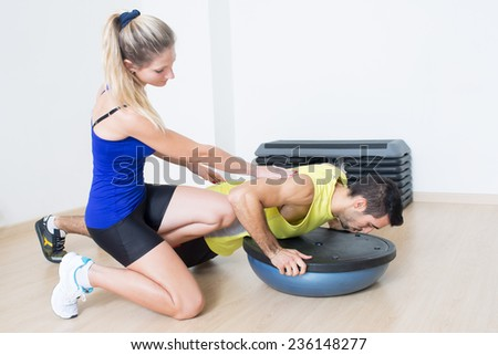 Female personal trainer explaining training - stock photo